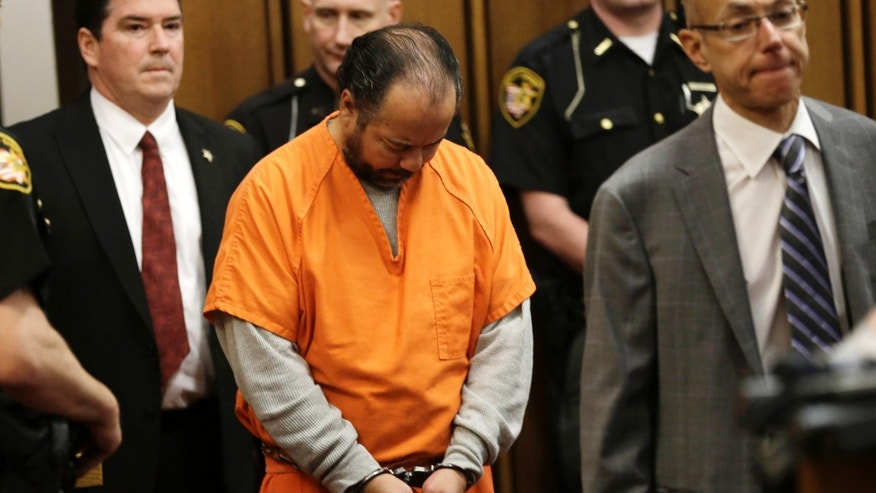 Ariel Castro enters the courtroom for his arraignment Wednesday, June 12, 2013, in Cleveland.