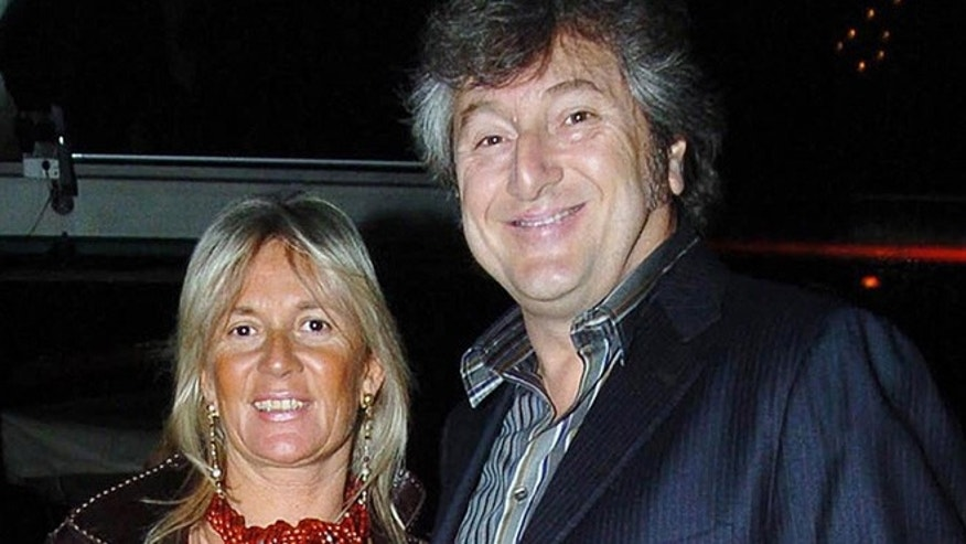 March 30, 2005: In this file photo, Vittorio Missoni, right, and his wife Maurizia Castiglioni pose for a photo in Milan, Italy. The underwater wreckage of a plane that disappeared off Venezuela on Jan. 4, 2013 with Missoni, the CEO of Italy's iconic Missoni fashion house, and five other people on board has been found, government officials and family members said Thursday, June 27, 2013.