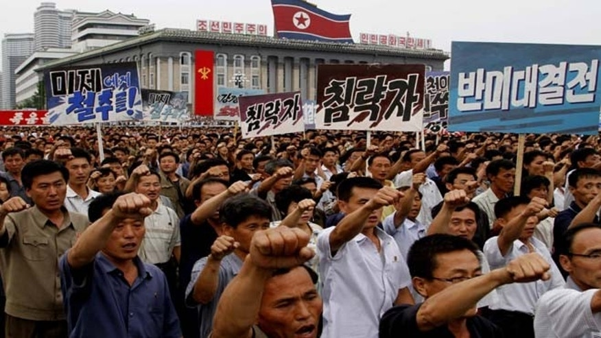 North Koreans march on Kim Il Sung Square in Pyongyang, North Korea as they hold an anti-U.S. demonstration on Tuesday, the 63rd anniversary of the outbreak of the three-year Korean War, from 1950 to 1953.