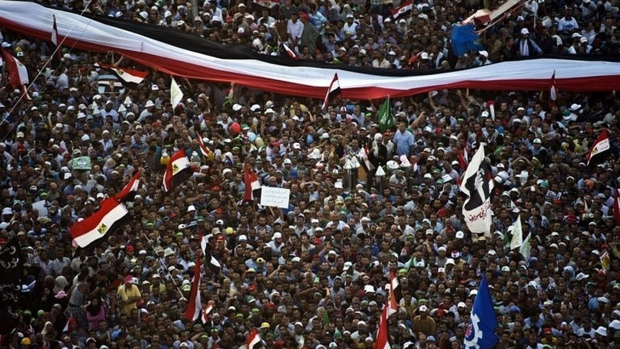 Supporters of Egyptian President Mohammed Morsi and the Muslim Brotherhood gather during a demonstration next to the Rabaa El-Adaweya mosque in the capital Cairo, on June 28, 2013. An American was among three people killed in Egypt on Friday as clashes erupted during rival demonstrations for and against Morsi a year after his election