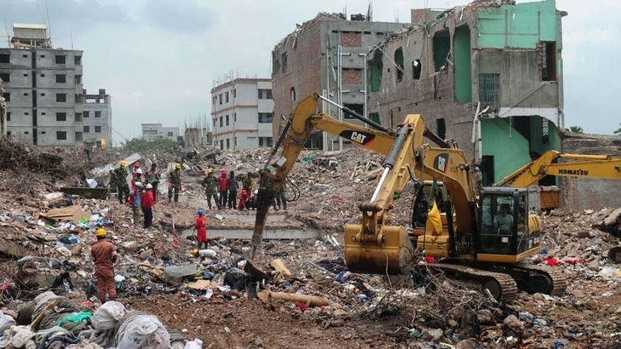 In this file photo, taken on May 10, 2013, Bangladeshi Army personnel continue rescue operation using heavy equipment after an eight-storey building collapsed in Savar, on the outskirts of Dhaka. Garment industry bosses as well as the government have been trying to persuade Western fashion firms not to move production out of the country in the wake of the factory complex's collapse.
