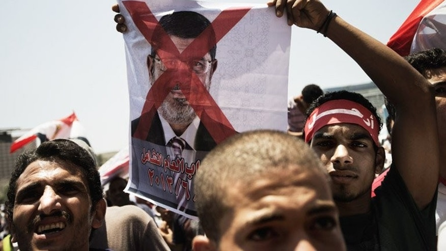 A crossed-out picture of Mohammed Morsi at a protest in Cairo's Tahrir Square on Saturday. More than 22 million people have signed a petition in Egypt demanding the departure of Islamist President Mohamed Morsi and a snap election, the opposition Tamarod (Arabic for rebellion) group said on Saturday.