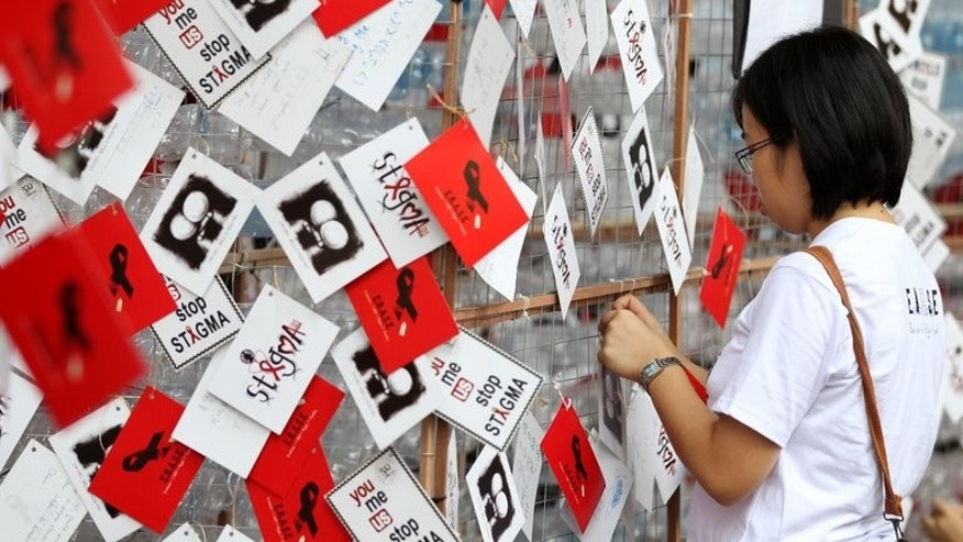 A display support for HIV positive people during a World Aids Day campaign in Kuala Lumpur last December. Thousands of delegates will attend the four-day International AIDS Society (IAS) Conference which starts on Sunday in the Malaysian capital, the first time the bi-annual meeting will be held in Asia.