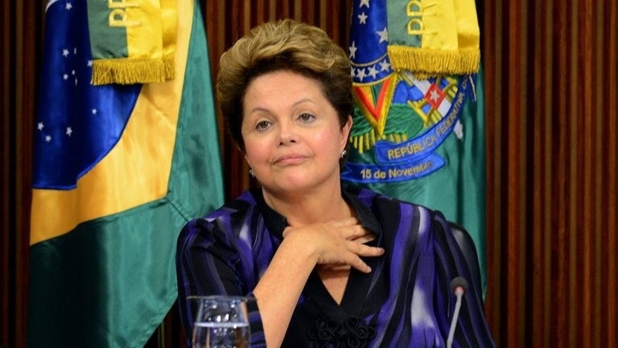 Brazilian President Dilma Rousseff attends a meeting with governors and city mayors at Planalto Palace in Brasilia, on June 24, 2013. A poll released Saturday found that Rousseff's popularity has taken a nosedive since nationwide street protests erupted over government corruption and rampant spending.