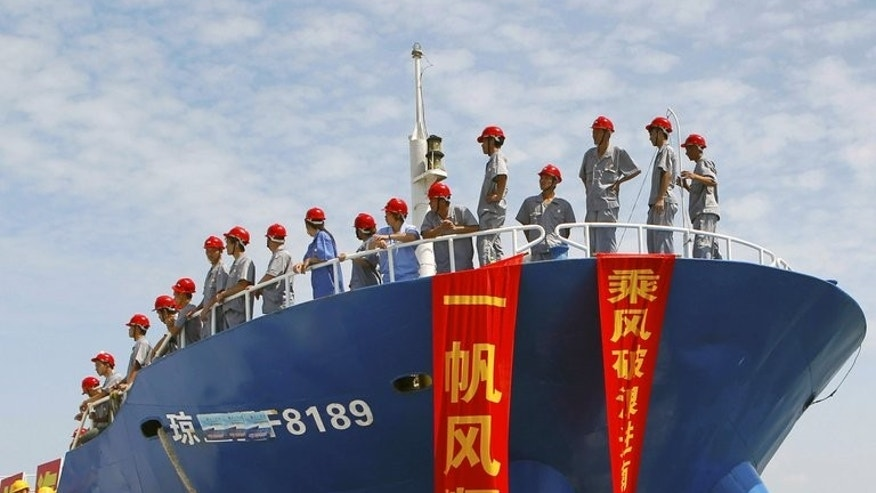 "A Chinese fishing craft sets sail for the Spratly Islands from Danzhou, south China's Hainan province, last month. Chinese state-media accused the Philippines of using the ASEAN group of nations as an ""accomplice"" in the violation of its sovereignty claims in the South China Sea on Saturday, and warned of a potential ""counterstrike""."
