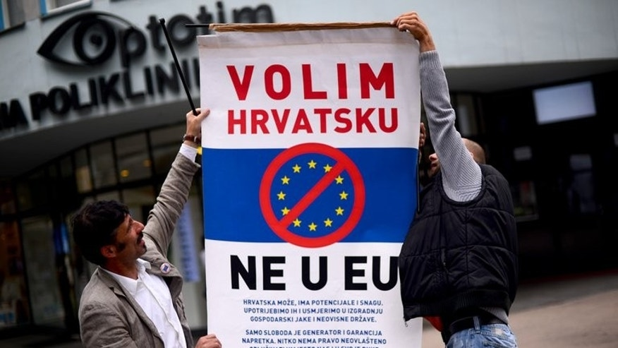 "Demonstrators display a poster reading ""We like Croatia, No in EU"" during a protest against the entry of Croatia into the European Union in Zagreb on June 29, 2013. Croatia on Sunday stages celebrations to mark its historic entry into the European Union as the bloc's 28th member, almost two decades after the end of the Balkan state's bloody war of independence from the former Yugoslavia."