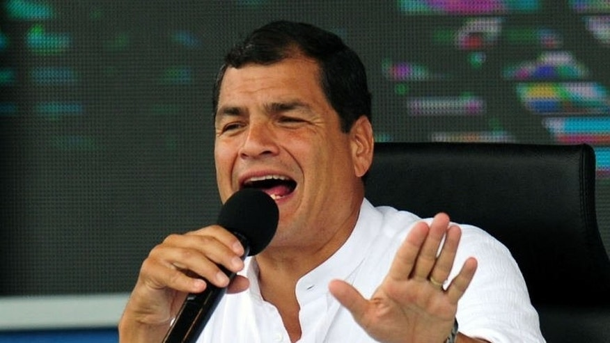 Ecuadorean President Rafael Correa speaks at the Refineria del Pacifico camp, in El Aromo, Manabi, on June 29, 2013. Correa said Saturday he has spoken with US Vice President Joe Biden about Edward Snowden, and that the American official asked Ecuador to reject the fugitive intelligence leaker's asylum request.