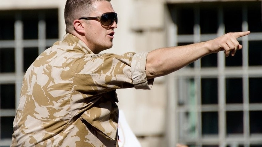 Leader of the far-right English Defence League (EDL) Tommy Robinson addresses supporters near Downing Street in London on May 27, 2013. Robinson was arrested after breaching a police order banning a march to the London site where a soldier was murdered last month, the group said.