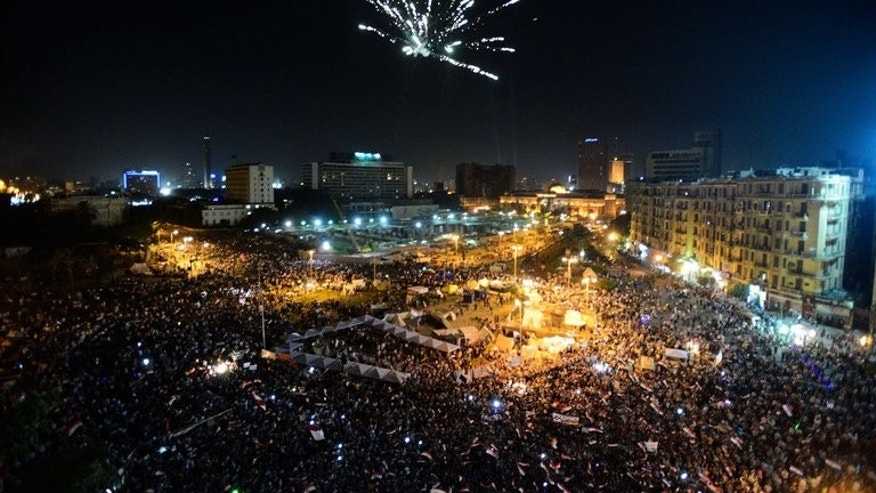 Fireworks light the sky as thousands of Egyptians gather to demonstrate against President Mohamed Morsi and the Muslim Brotherhood in Cairo's landmark Tahrir Square late on June 28, 2013. Washington warned against travel to Egypt after an American was among three people killed during rival demonstrations for and against Morsi ahead of Sunday's anniversary of his turbulent maiden year in office