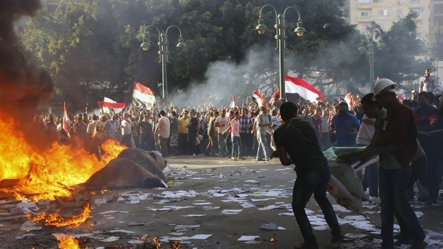 Opponents of Egyptian President Mohamed Morsi burn the contents of a Freedom and Justice Party office in the coastal city of Alexandria on June 28, 2013. Washington warned against travel to Egypt after an American was among three people killed during rival demonstrations for and against Morsi ahead of Sunday's anniversary of his turbulent maiden year in office