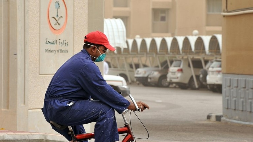 A foreign worker rides near the King Fahad hospital in Hofuf, east of Riyadh. Virologists are casting a worried eye on this year's Islamic hajj pilgrimage to Saudi Arabia as they struggle with the enigmatic, deadly virus known as MERS which is striking hardest in the kingdom.
