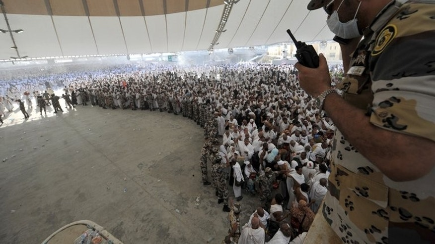 Hajj pilgrims queue to throw pebbles at pillars in the Jamarat ritual, the stoning of Satan, in Mina near Mecca last October. Little is known about the new MERS virus beyond the fact that it can be lethal by causing respiratory problems, pneumonia and kidney failure.