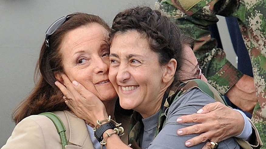 "Following her release from captivity, former hostage Ingrid Betancourt (R) hugs her mother Yolanda Pulecio upon her arrival at the Catam air base in Bogota, Colombia, on July 2, 2008. Five years after being released by her FARC abductors, Betancourt on June 27, 2013 urged ""forgiveness"" as a crucial element to achieve peace in Colombia."