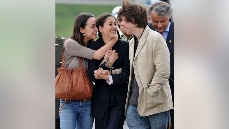 Freed Colombian hostage Ingrid Betancourt (C) welcomes her children Melanie (L) and Lorenzo Delloye upon their arrival at the airport in Bogota on July 3, 2008, after she was held captive for six years by the FARC. Five years after being released, Betancourt is now studying for a doctorate's degree in theology at Oxford University.
