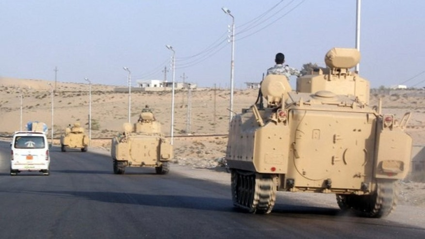 A convoy of Egyptian armoured vehicles head along a road in El-Arish in the Sinai Peninsula on August 13, 2011. Gunmen shot and killed an Egyptian police officer during an ambush Saturday in El-Arish, a security source said, the second attack on police in the restive region this month.