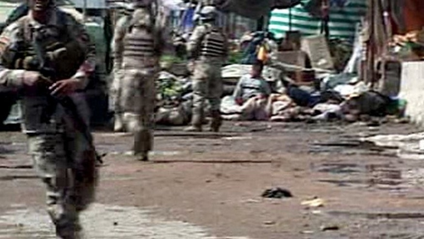 A grab from an Al-Iraqiya TV video shows soldiers on the scene of a bombing at a market in Abu Ghraib in March 2009. Attacks in Sunni Arab towns surrounding Baghdad killed six people on Saturday, the latest in spiralling violence that has left more than 420 dead this month and sparked fears of renewed sectarian war.