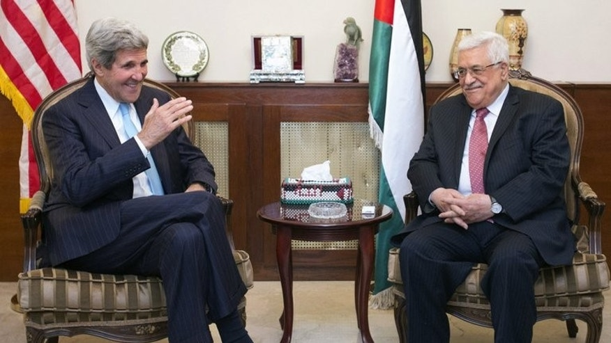 John Kerry (left) meets Palestinian president Mahmud Abbas in the Jordanian capital Amman on Friday. Kerry extended for a third day on Saturday his shuttle diplomacy between Israeli and Palestinian leaders, raising speculation of progress in reviving long dormant peace talks.