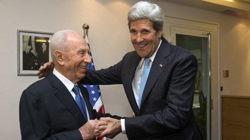 US Secretary of State John Kerry (R) meets with Israeli President Shimon Peres in Jerusalem on June 28, 2013. In a commute to which he has grown accustomed, Kerry will take a helicopter from Jerusalem to Amman to see Palestinian president Mahmud Abbas before returning in the evening to follow up with Israeli leaders.