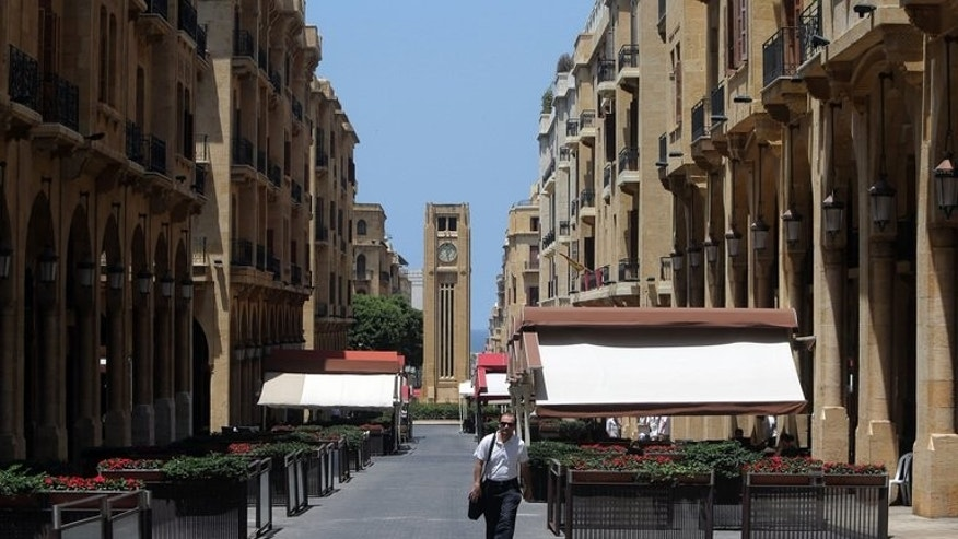 A man walks past empty restaurants in downtown Beirut on June 26, 2013. The city is dubbed party capital of the Middle East and is usually crowded by tourists at this time of the year.