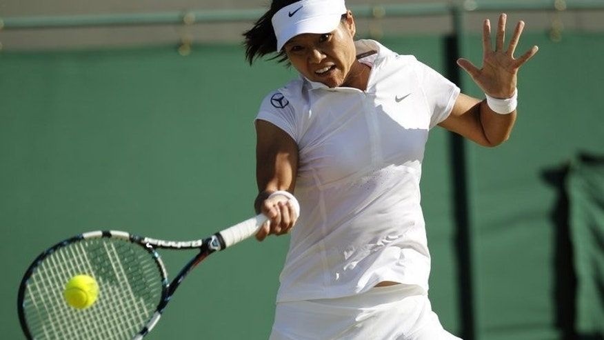 China's Li Na returns against Czech Republic's Klara Zakopalova in their third round women's singles match in Wimbledon, London, on June 29, 2013. Na came through a disjointed match with Zakopalova on Saturday to book her place in the Wimbledon fourth round.