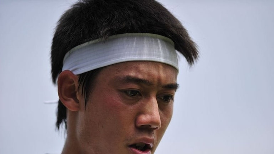 Japan's Kei Nishikori plays against Italy's Andreas Seppi in their third round match at Wimbledon on June 29, 2013. Nishikori has vowed to bounce back from his frustrating Wimbledon exit by turning on the style during the US hardcourt season.
