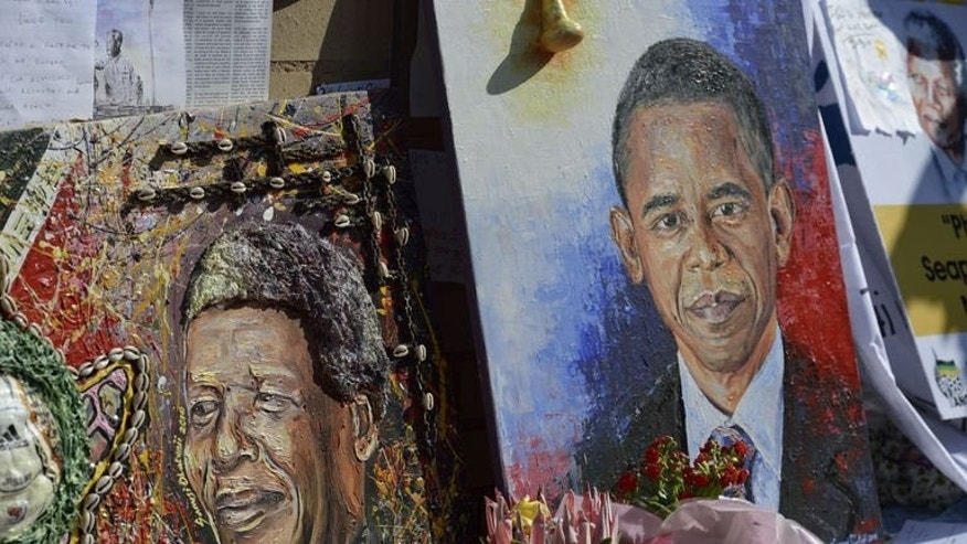 Oil paintings showing former South African President Nelson Mandela and US President Barack Obama are displayed outside the Mediclinic Heart Hospital where Mandela is being treated on June 29, 2013 in Pretoria. Obama met the family of his critically ill hero Mandela on a visit to South Africa, the White House said.
