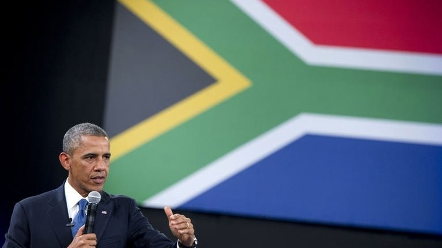 US President Barack Obama answers a question during a town hall meeting at the University of Johannesburg Soweto in Johannesburg, South Africa, on June 29, 2013. Obama will visit Nelson Mandela's apartheid prison cell on Sunday, paying homage to the ailing South African hero whose humbling forgiveness of his oppressors inspired the world.