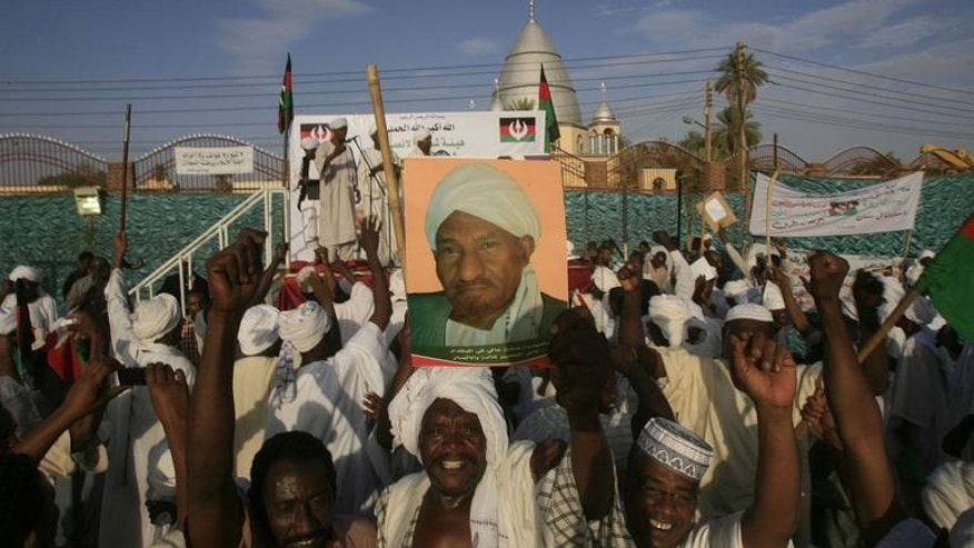 "Supporters of former prime minister and now head of the National Umma Party Sadiq al-Mahdi (poster) rally in Khalifa Square in Sudan's twin capital of Omdurman on June 29, 2013. Crowds chanted for an end to President Omar al-Bashir's regime, yelling, ""Bashir go, go."""
