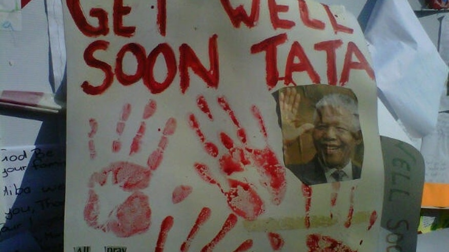 Get well signs crowd the fences nearby the hospital where Nelson Mandela is receiving treatment.