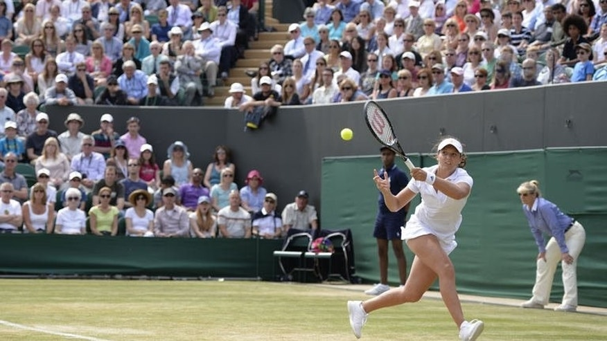 Britain's Laura Robson returns against New Zealand's Marina Erakovic in their third round women's singles match on day six of Wimbledon at the All England Club in London, on June 29, 2013. Robson won 1-6, 7-5, 6-3.