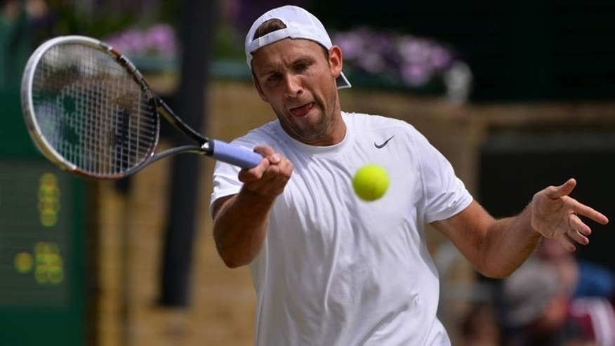 Poland's Lukasz Kubot returns against France's Benoit Paire in their third round match in Wimbledon on June 29, 2013. The unheralded Kubot and fellow twilight zone journeyman, Kenny de Schepper of France, capitalised on the culling of Wimbledon seeds to secure surprise fourth round spots.