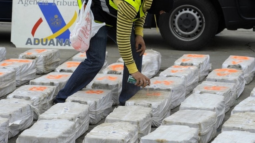 A Spanish policeman marks packs of cocaine seized at the port of Vigo, northwestern Spain. Spanish police said Saturday they had seized hundreds of thousands of packets of unlicensed medicine illegally imported from China and India, including erection aids and slimming products.