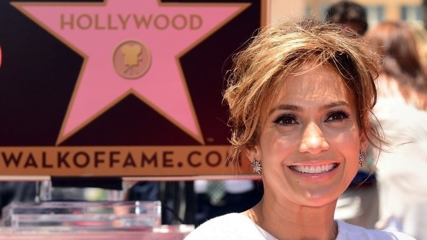 International superstar Jennifer Lopez smiles in Hollywood, California on June 20, 2013. Lopez is set to perform Saturday at lavish birthday celebrations for Turkmenistan leader Gurbanguly Berdymukhamedov at a $2 billion dollar Caspian Sea resort.