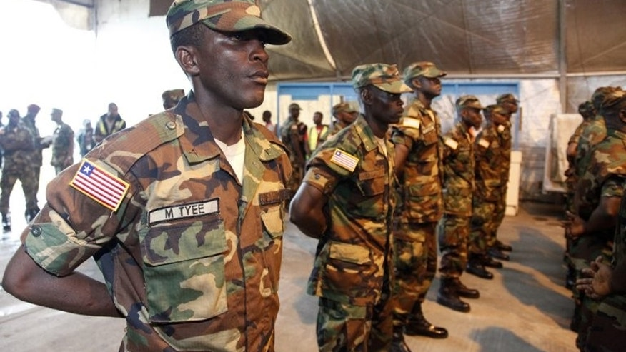 Liberian troops stand in rows in Monrovia before embarking on a peacekeeping mission to Mali, on June 20, 2013. UN soldiers will take over from African troops in conflict-scarred Mali from July 1, making up the organisation's third-largest peacekeeping force by the end of the year.