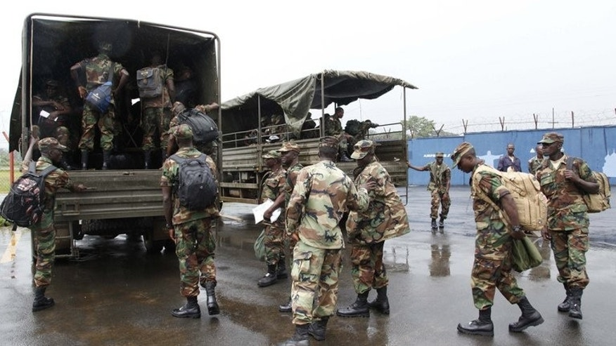 Liberian troops get onto military vehicles in Monrovia as they embark on a peacekeeping mission to Mali, on June 20, 2013. UN soldiers will take over from African troops in conflict-scarred Mali from July 1, making up the organisation's third-largest peacekeeping force by the end of the year.