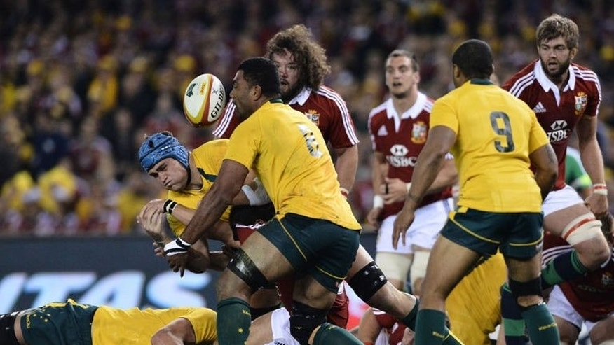 Wycliff Palu of Australia (centre) eyes the ball during the second rugby Test between the British and Irish Lions and the Australian Wallabies in Melbourne on June 29, 2013.