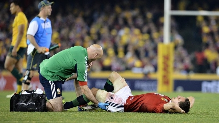 Lions captain Sam Warburton lies injured during the second Test against the Wallabies in Melbourne on June 29, 2013. Warburton will undergo a scan on his hamstring in Melbourne before rejoining a squad who face a deciding third Test next weekend.