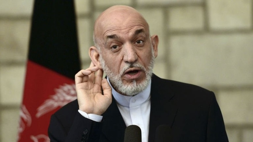 Afghan President Hamid Karzai gives a press conference at the Presidential Palace in Kabul, June 29, 2013. The Afghan government on Sunday said talks on a key security pact with the US would only re-start when Taliban rebels meet with Kabul's negotiators, further complicating efforts to revive the country's troubled peace process.