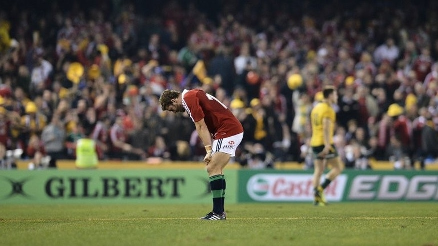Leigh Halfpenny reacts after missing a crucial late penalty kick against Australia on June 29, 2013. Australia's Kurtley Beale said he knew how British and Irish Lions superboot Halfpenny felt.