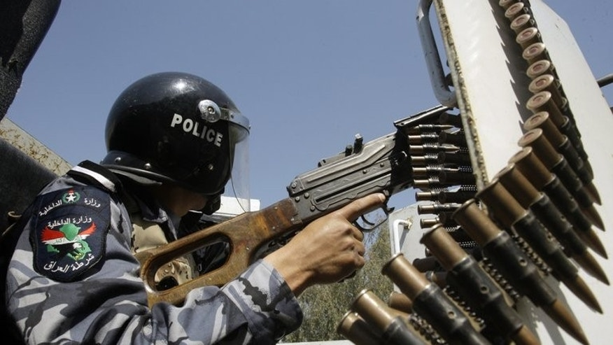 An Iraqi policeman patrols in the eastern Baghdad area of Nahrawan on March 30, 2011. A bombing at a Baghdad football pitch killed nine people Sunday, the majority of them young boys, officials said, the latest in a series of attacks targeting Iraqis playing and watching football.