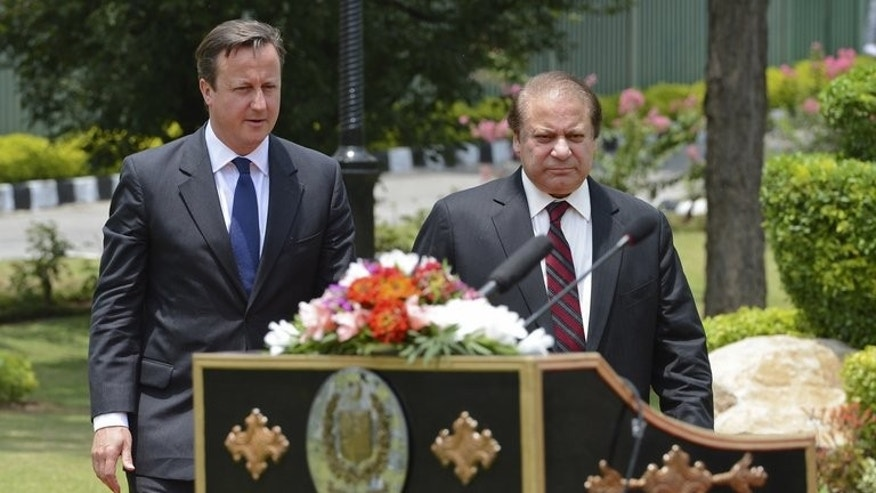 "David Cameron (left) with Nawaz Sharif at the prime minister's house in Islamabad on Sunday. Cameron said the battle against terrorism needed ""a tough and uncompromising security response"" as well as investment in education and tackling poverty."