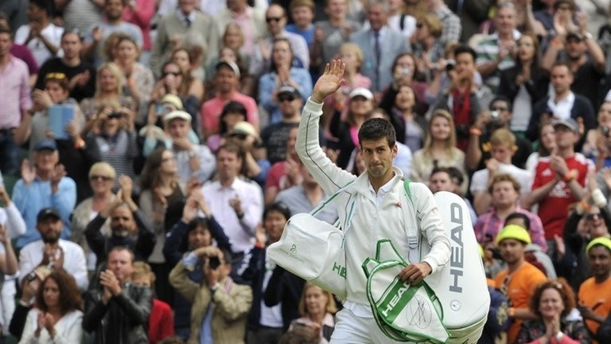 Novak Djokovic waves to the crowd after beating Jeremy Chardy in the third round at Wimbledon on June 29, 2013. Djokovic won 6-3, 6-2, 6-2 and takes on 35-year-old Tommy Haas, the oldest player left in the men's draw, on Monday.