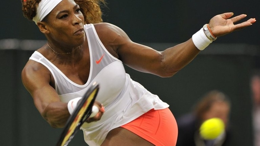 Serena Williams returns against Kimiko Date-Krumm in the third round of Wimbledon on June 29, 2013. Williams, chasing a sixth Wimbledon title and 17th Grand Slam crown, faces German 23rd seed Sabine Lisicki for a quarter-final place.