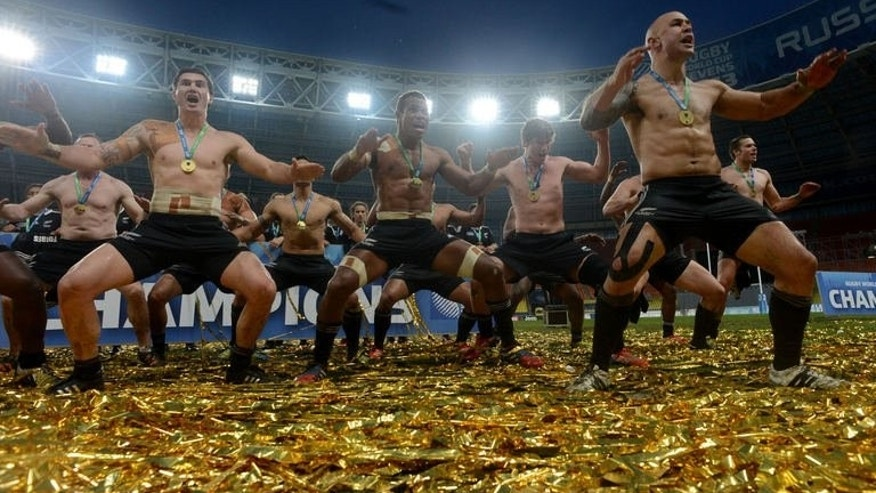 New Zealand's players dance and sing as they celebrate their victory over England in the Rugby World Cup Sevens 2013 final match in the Luzhniki Stadium in Moscow on June 30, 2013. New Zealand won 33-0.
