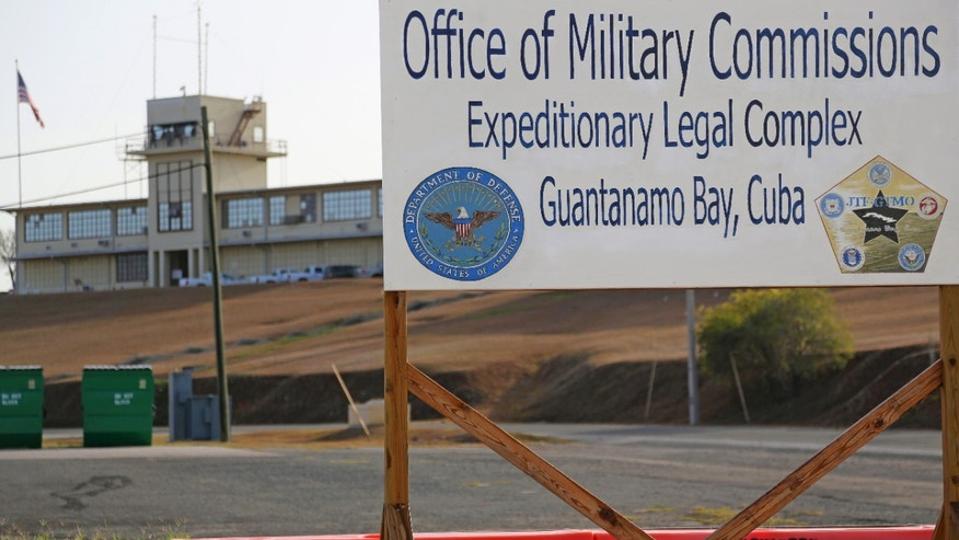 A sign is seen outside the Courthouse One Expeditionary Legal Complex at Naval Station Guantanamo Bay, Cuba, Monday, June 17, 2013, as Military Commission preliminary hearings reconvened in the case against Khalid Shaikh Mohammed and his fellow 911 co-conspirators. Five Guantanamo Bay prisoners accused of helping orchestrate the Sept. 11 terrorist attacks are due back in court as the U.S. government tries to push the long-stalled case forward.  (AP Photo/Bill Gorman)