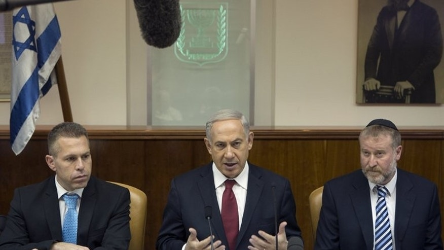 Benjamin Netanyahu (centre) chairs the weekly cabinet cabinet meeting in Jerusalem on Sunday. Hardliners within the Israeli prime minister's Likud are poised to seize key positions in the party's governing institutions on Sunday in a move likely to curb any concessions vis-a-vis the Palestinians.