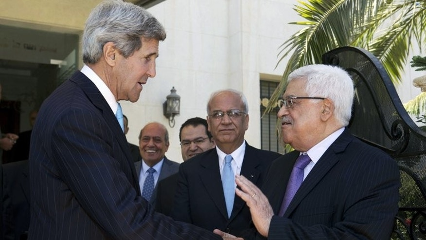 US Secretary of State John Kerry (L) bids farewell to Palestinian president Mahmud Abbas after their second meeting in the Jordanian capital Amman on June 29, 2013. Kerry made a last-minute push on Sunday to revive Middle East peace talks as Israeli media said that days of exhaustive shuttle diplomacy had failed to break the deadlock.