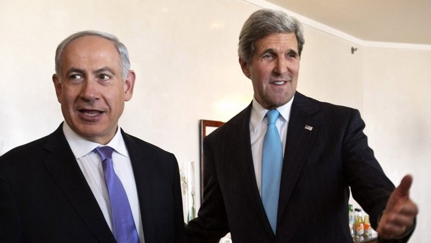 US Secretary of State John Kerry (R) speaks with Israeli Prime Minister Benjamin Netanyahu during a second meeting in Jerusalem on June 28, 2013. Kerry made a last-minute push on Sunday to revive Middle East peace talks as Israeli media said that days of exhaustive shuttle diplomacy had failed to break the deadlock.