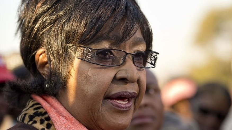 The former wife of Nelson Mandela, Winnie Madikizela-Mandela, speaks to the media outside their first family home in Soweto on June 28, 2013. Winnie has strongly criticised a visit paid by South African President Jacob Zuma in April to the ailing anti-apartheid icon, who is again critically ill in hospital.