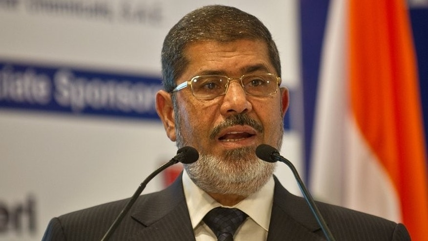 "Egyptian President Mohamed Morsi addresses a gathering during India-Egypt Economic Forum in New Delhi on March 20, 2013. Morsi, an Islamist who pledged to be a ""president for all Egyptians"" at his inauguration, faces mass rallies demanding his departure on the first anniversary of his taking office."